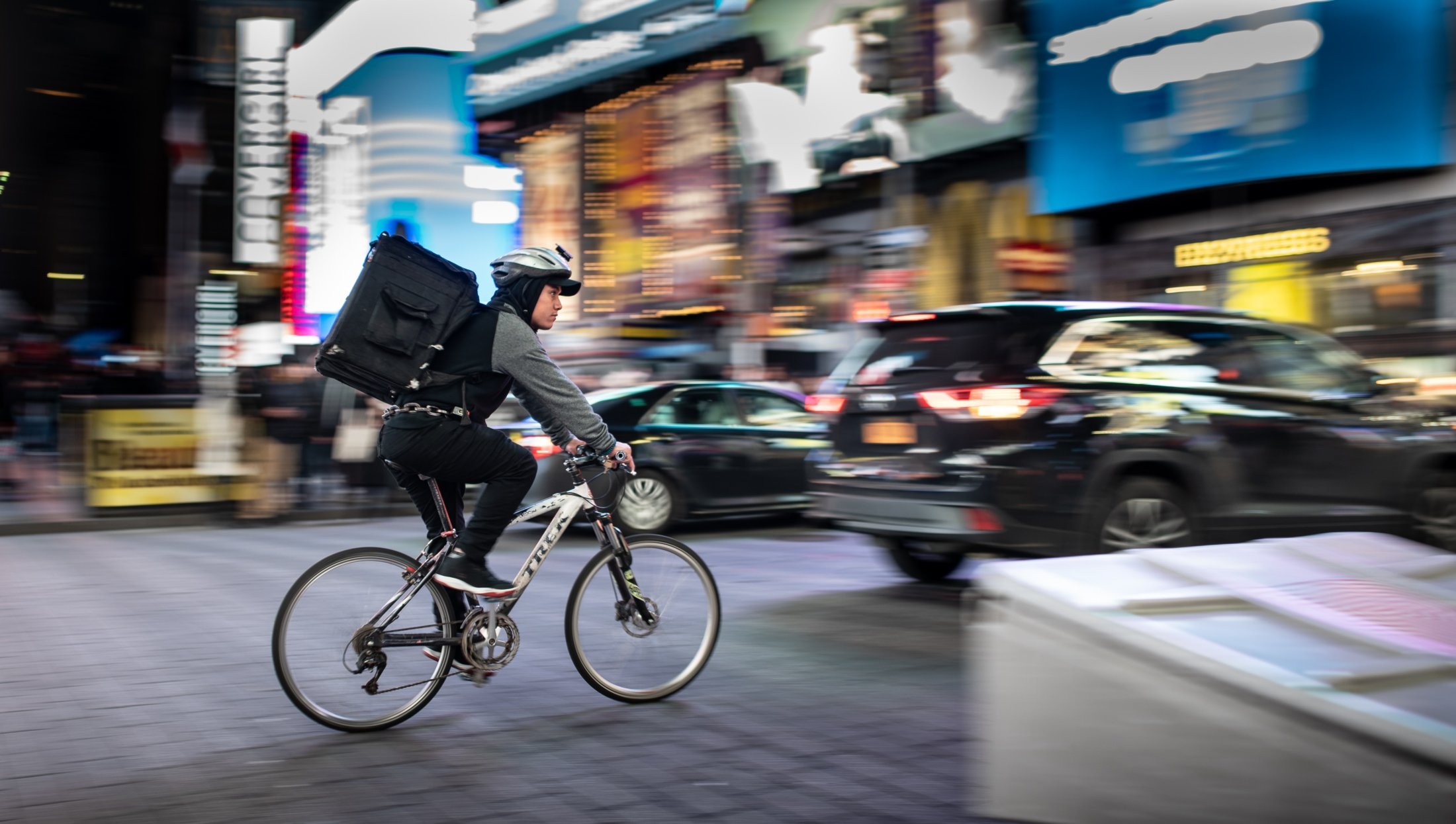 Delivery person riding a bike